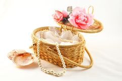 Pearl in basket Stock Images