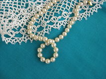 Pearl bead and lace Stock Images