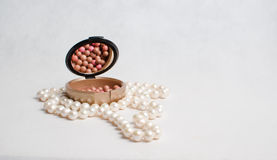 Pearl beads and a box of rouge Royalty Free Stock Image