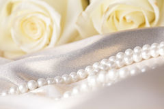 Pearl beads and cream rose Royalty Free Stock Photo