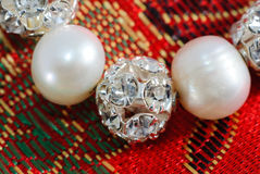 Pearl beads with crystal spheres Royalty Free Stock Image