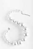 Pearl beads. Elegant jewelary beads with jewel stone sea white pearl on white background Stock Images