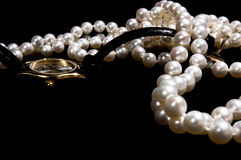 Pearl beads with female  watch Royalty Free Stock Images