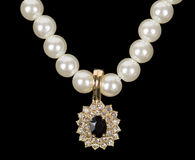 Pearl beads and a gold pendant Royalty Free Stock Images