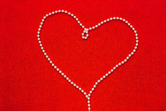 Pearl beads in Heart shape Royalty Free Stock Images
