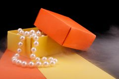 Pearl Beads In Opened Homemade Paper Gift Box On On Fogged Surface And Dark Background. Stock Images