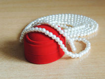 Pearl beads. On a red velvet boxes Royalty Free Stock Image