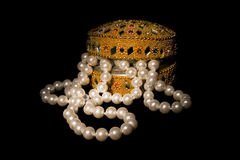 Pearl beads in the slightly opened casket Royalty Free Stock Photo