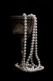 Pearl beads with  wineglass Royalty Free Stock Images