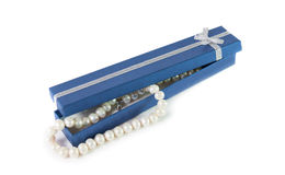 Pearl bijouterie necklace and  blue gift box isolated Stock Photography