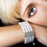 Pearl bracelet. Beautiful woman with pearl bracelet Royalty Free Stock Image