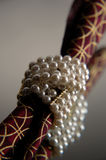 Pearl bracelet. Still life with jewelry and fabric stock photo