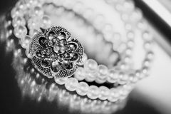 Pearl bracelet. Close-up of vintage pearl bracelet in bw tone Royalty Free Stock Photo