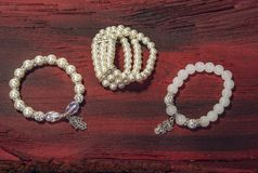 Pearl bracelet custom jewelry on the wood or stone background. Royalty Free Stock Images