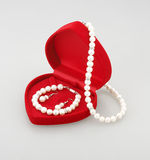 Pearl bracelet earring and necklace isolated  Stock Photo