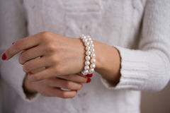 Pearl bracelet on her arm. Bracelet of pearls on a female hand Royalty Free Stock Photo