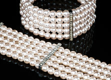 A pearl bracelet and a necklace (close-up) Royalty Free Stock Image