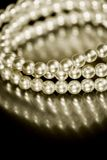 Pearl bracelet in sepia tone. Close-up of vintage pearl bracelet in sepia tone Stock Image