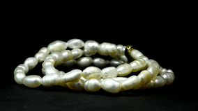 Pearl bracelet on turn table. Cultured freshwater pearls stock video footage