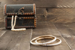 Pearl bracelet and vintage box with jewelry Royalty Free Stock Image