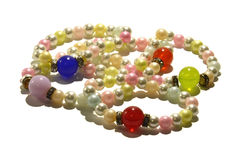 Pearl bracelets. Bracelets made of artificial pearls with large, colorful beads. Photo taken on a white background Stock Image