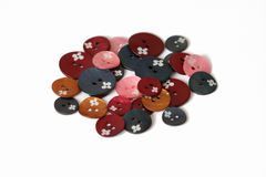 Pearl Buttons. Lying on a white table, close-up Royalty Free Stock Photos