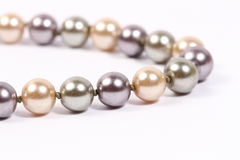 Pearl chain in white background. Different color pearl chain in white background Stock Photography