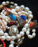 Pearl chains and rings with coloures glass such as Swarovsky look liked as rubin and sapphire. From India. Pearl chains and rings with coloures glass such as stock photo
