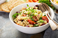 Pearl couscous salad with fresh vegetables Stock Photos