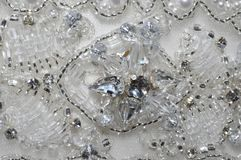Pearl and Crystal Wedding Dress Detail. Pearl and Crystal Detail on a Wedding Dress Stock Photo