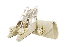 Pearl decorated gold shoes and purse Royalty Free Stock Photo