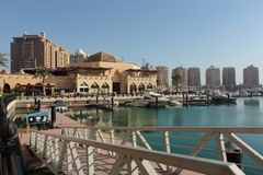 The Pearl development in Qatar. THE PEARL, QATAR - FEBRUARY 3, 2018:  A view of the Porto Arabia section of the massive The Pearl residential development in West Stock Photos