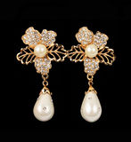 Pearl earrings Stock Photos