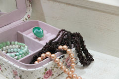 Pearl and garnet necklace in a pink box Stock Images