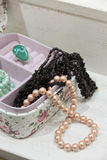 Pearl and garnet necklace in a pink box Royalty Free Stock Images