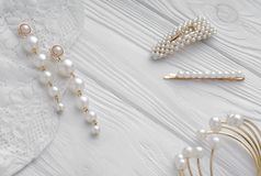 Pearl golden Earrings, hairpins and bracelet on white background. Pearl golden Earrings on white textile, hairpins and bracelet on white background royalty free stock photos