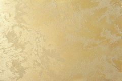 Pearl golden effect decorative plaster art background. For interior Stock Photography
