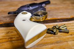 Pearl Handled .22 caliber Pistol with Bullet`s stock photos