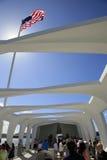Pearl Harbor, Hawaii. USS Arizona Memorial is seen as visitors walk thru Memorial Stock Image