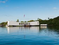 Pearl Harbor Memorial. With flag reflected in the water Stock Photos