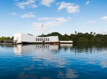 Pearl Harbor Memorial. With flag reflected in the water Royalty Free Stock Photos
