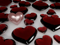A pearl heart among glass hearts Royalty Free Stock Photos