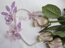 Pearl heart and macrame flowers with roses Royalty Free Stock Photo