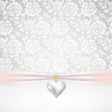 Pearl heart pendant. Template for wedding, invitation or greeting card with lace fabric background and pearl heart pendant royalty free illustration