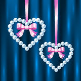Pearl hearts with pink ribbons and bows Royalty Free Stock Photos