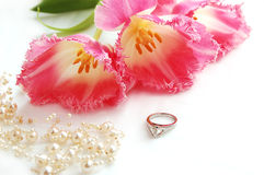 Pearl jewelery. Pink tulips with ring and pearl jewelery Stock Image