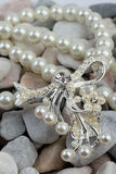 Pearl jewelery on stones Royalty Free Stock Images