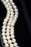 Pearl jewelry. Elegant pearls in a jewelry gift box Royalty Free Stock Images