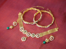 Pearl Jewelry. Pearl studded gold necklace, bracelets, and earrings Royalty Free Stock Images