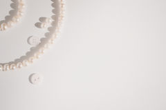 Pearl jewelry on paper with copy space Royalty Free Stock Photography